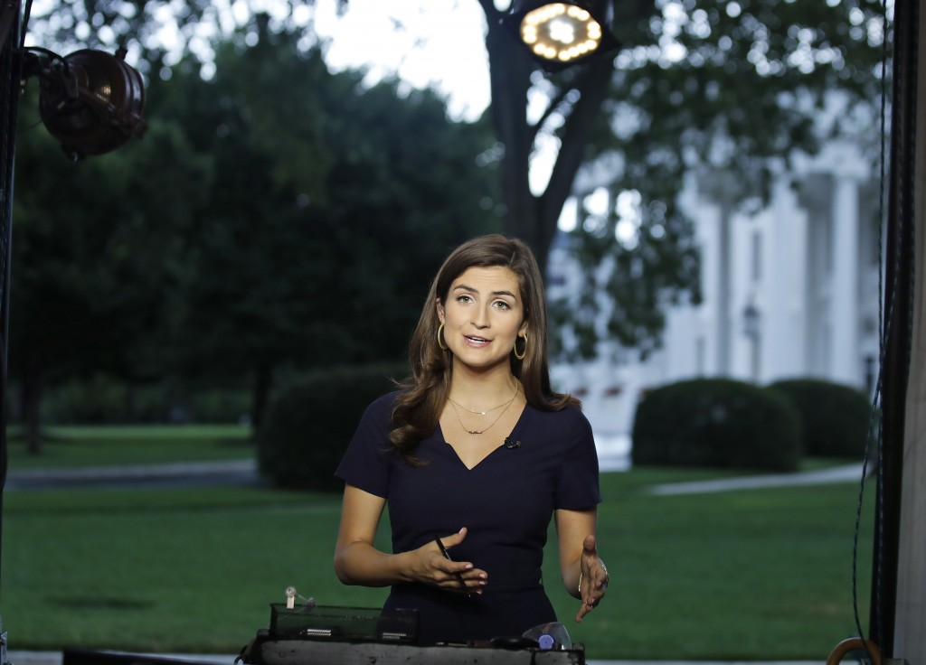 FILE - This July 25, 2018 file photo shows CNN White House correspondent Kaitlan Collins during a live shot in front of the White House in Washington....