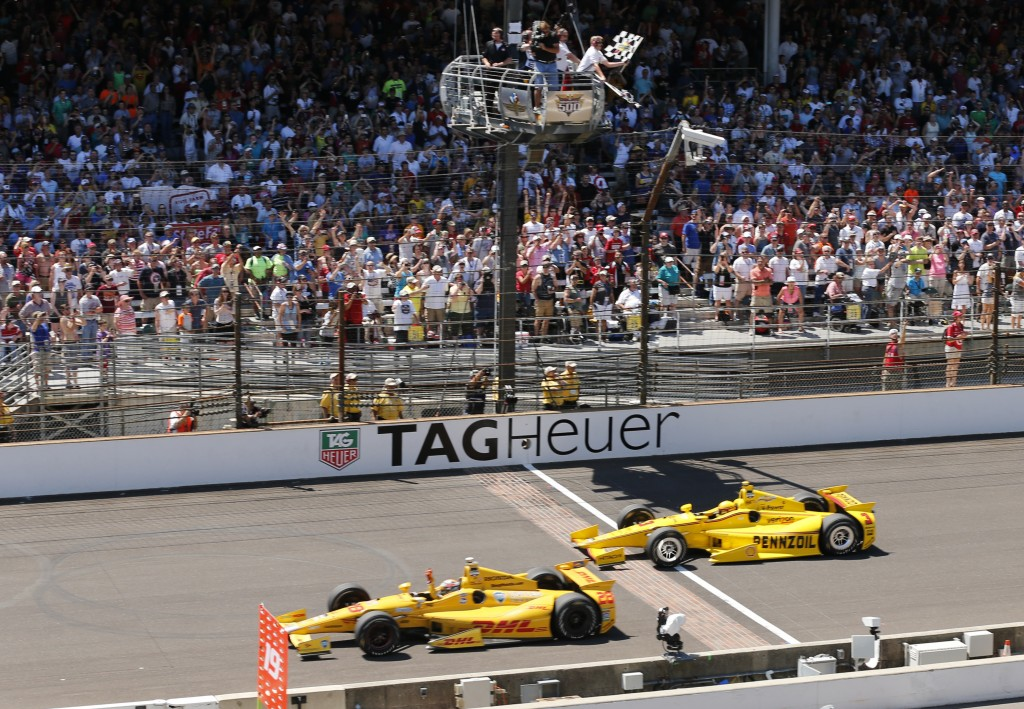 FILE - In this May 25, 2014, file photo, Ryan Hunter-Reay celebrates after crossing the finish line, taking the checkered flag in front of Helio Castr...