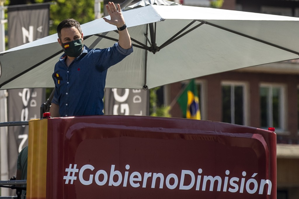 Leader of far right party Vox Santiago Abascal waves during a drive-in protest organised by Spain's far-right party Vox against the Spanish government...