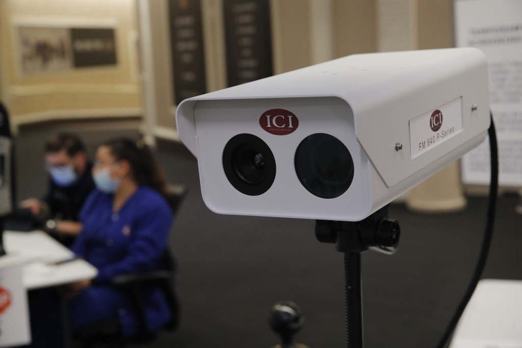 An infrared camera used to measure employee's temperatures is set up at an employee entrance during a closure due to the coronavirus at the Bellagio h...