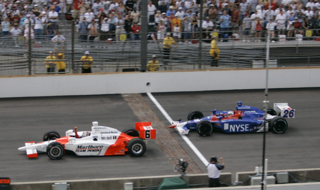 FILE - In this May 28, 2006, file photo, Sam Hornish Jr., left, pumps his fist as he beats Marco Andretti to the finish line to win the Indianapolis 5...