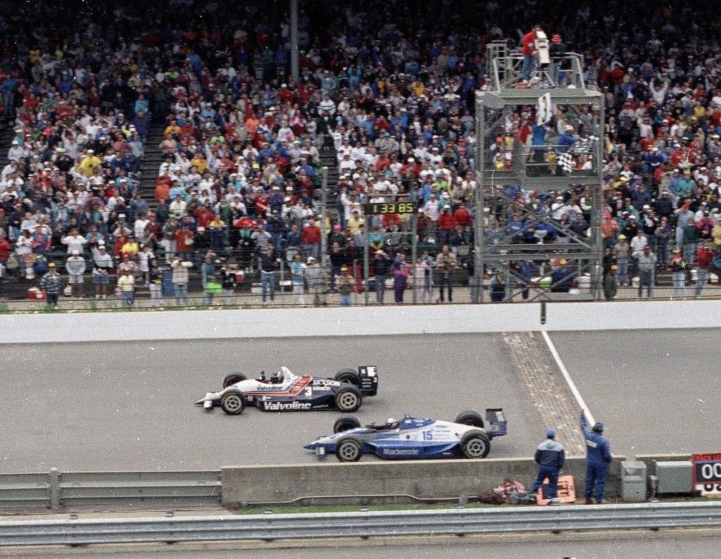 FILE - In this May 24, 1992, file photo, Al Unser Jr., top, wins the Indianapolis 500 auto race by less than a car length ahead of Scott Goodyear in t...