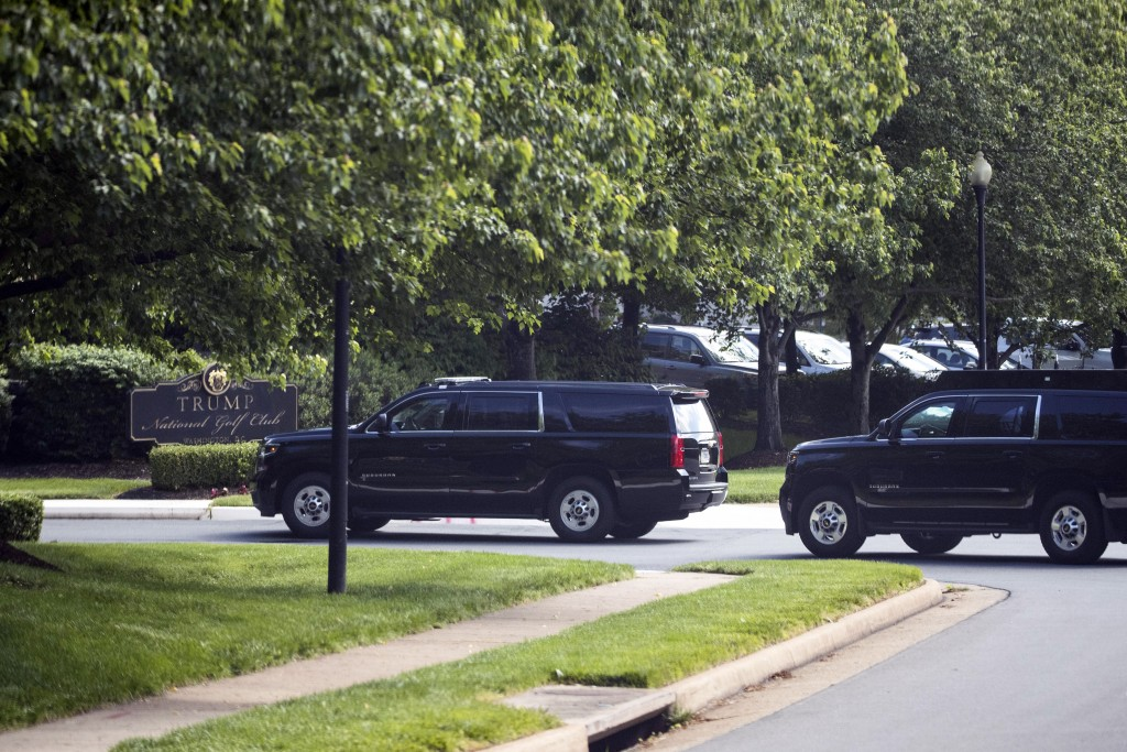 The motorcade for President Donald Trump arrives at Trump National Golf Club Saturday