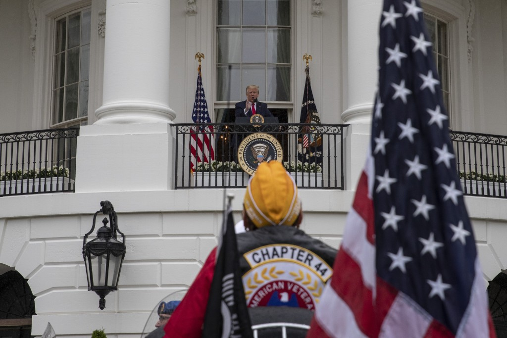 """President Donald Trump speaks during a """"Rolling to Remember Ceremony,"""" to honor the nation's veterans and POW/MIA, from the Blue Room Balcony of the W..."""