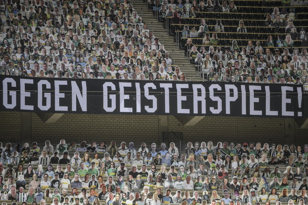 """A banner reading """"Against ghost matches"""" is displayed during the German Bundesliga soccer match between Borussia Moenchengladbach and Leverkusen, in M..."""