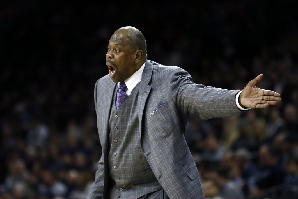 FILE - In this Saturday, Jan. 11, 2020, file photo, Georgetown head coach Patrick Ewing yells to his team during the first half of an NCAA college bas...