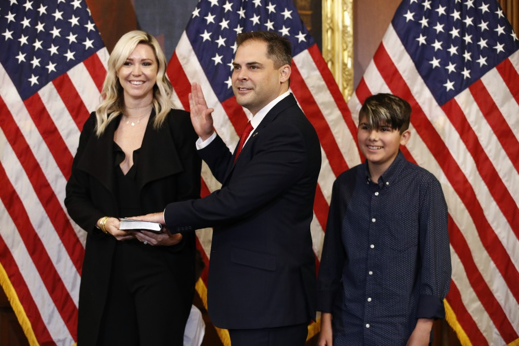 FILE - In this May 19, 2020, file photo Rep. Mike Garcia, R-Calif., center, joined by his wife Rebecca and son Preston, participates in a ceremonial s...
