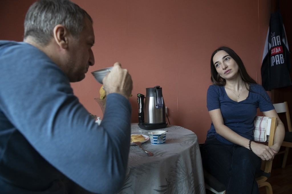 In this photo taken on Saturday, May 16, 2020, Dr. Osman Osmanov drinks coffee with his wife Saida at home after his shift at an intensive care unit o...