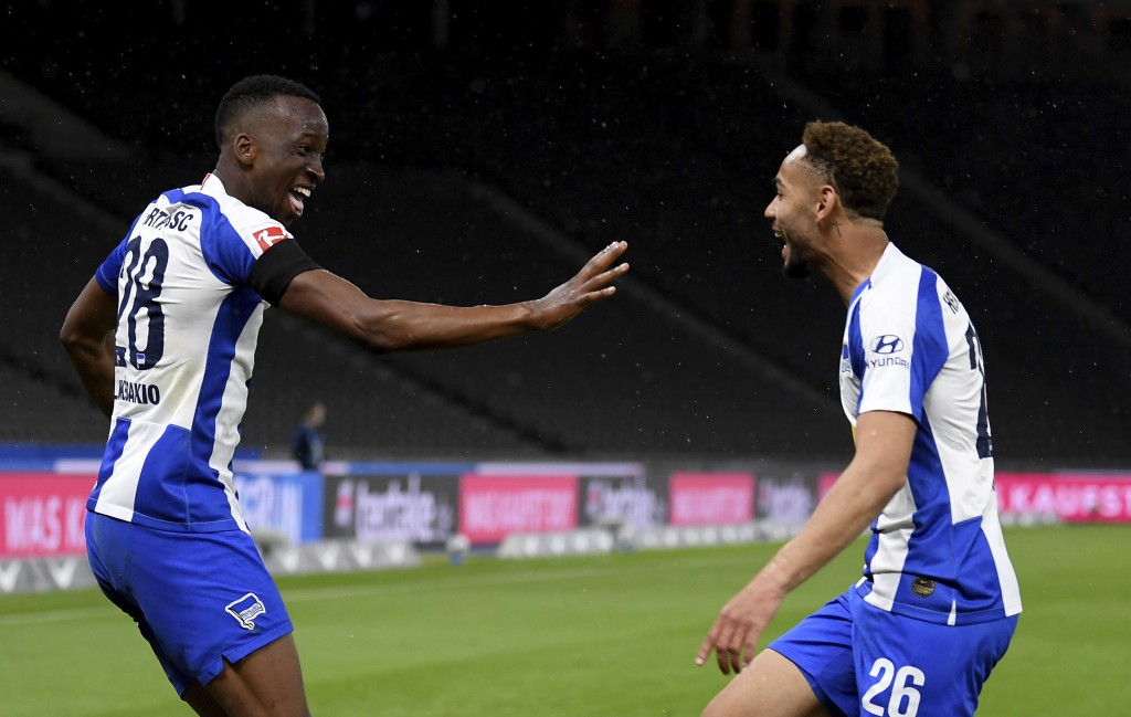 Hertha's scorer Dodi Lukebakio, left, and his teammate Matheus Santos, right, celebrate their side's second goal  during the German Bundesliga soccer ...