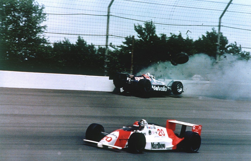 FILE - In this May 28, 1989, file photo, Emerson Fittipaldi, bottom, takes the lead with less than two laps remaining as Al Unser Jr. crashes into the...