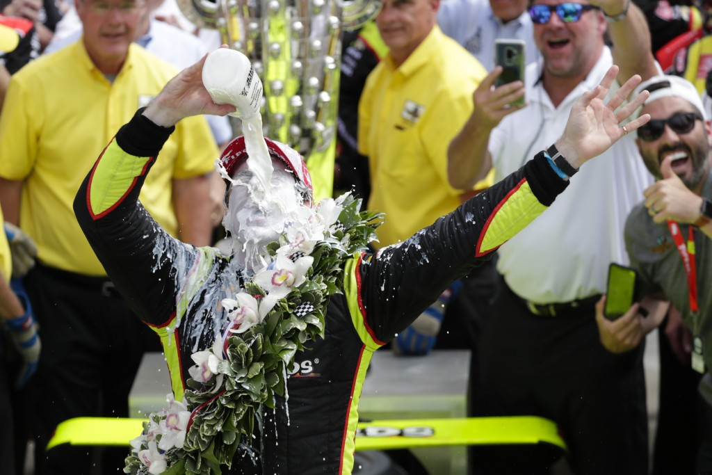 FILE - In this May 26, 2019, file photo, Simon Pagenaud, of France, celebrates by pouring milk on himself after winning the Indianapolis 500 IndyCar a...