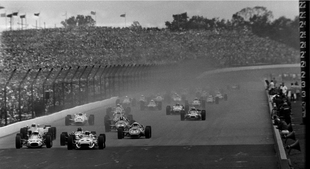 FILE - In this May 30, 1967, file photo, Mario Andretti (1) leads the field at the start of the 51st running of the Indianapolis 500 at Indianapolis M...