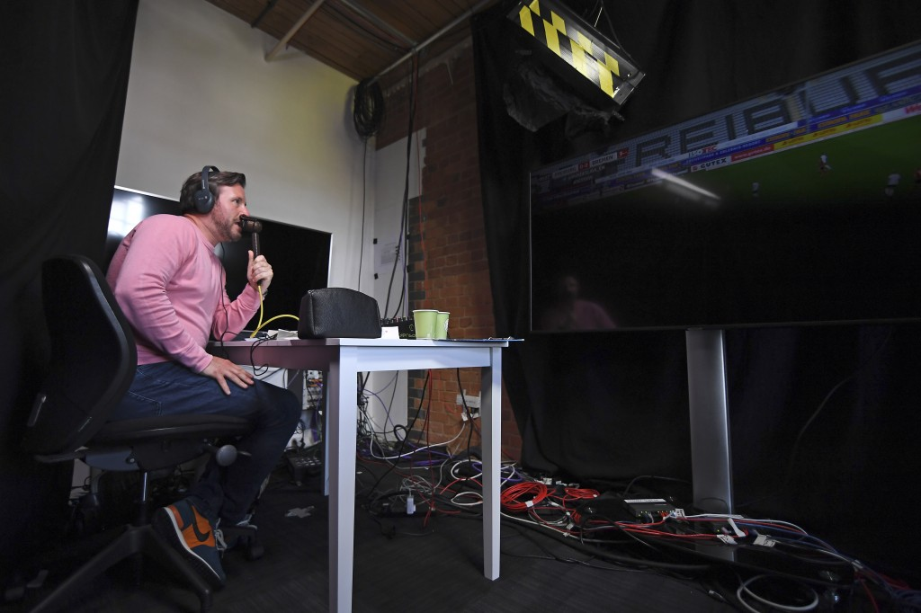 Soccer commentator Dan O'Hagan commentates on the German Bundesliga soccer match between Freiburg and Werder Bremen remotely from a studio in Camden T...