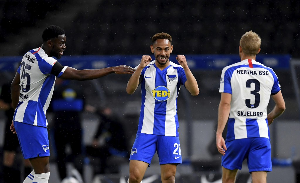 Hertha's Matheus Santos Carneiro Da Cunha, center, celebrates scoring his side's third goal during the German Bundesliga soccer match between Hertha B...