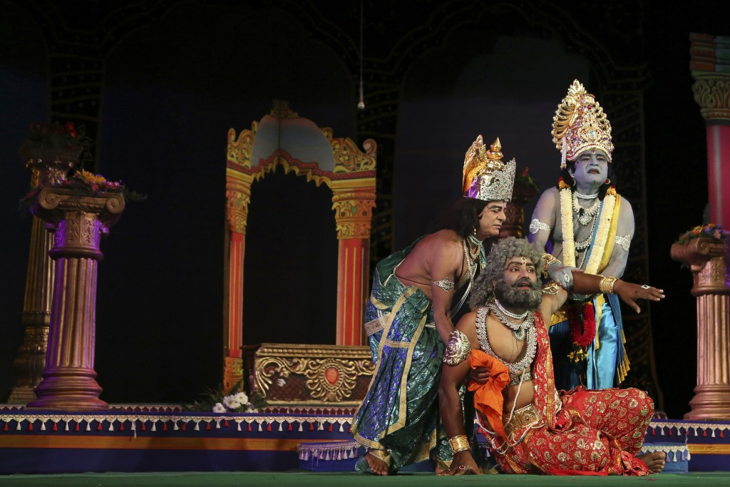 FILE- In this Nov. 2, 2015, file photo, Indian actors dressed as Rama, right, Dasharatha, center, and Laxman, the characters of Hindu epic Ramayana pe...