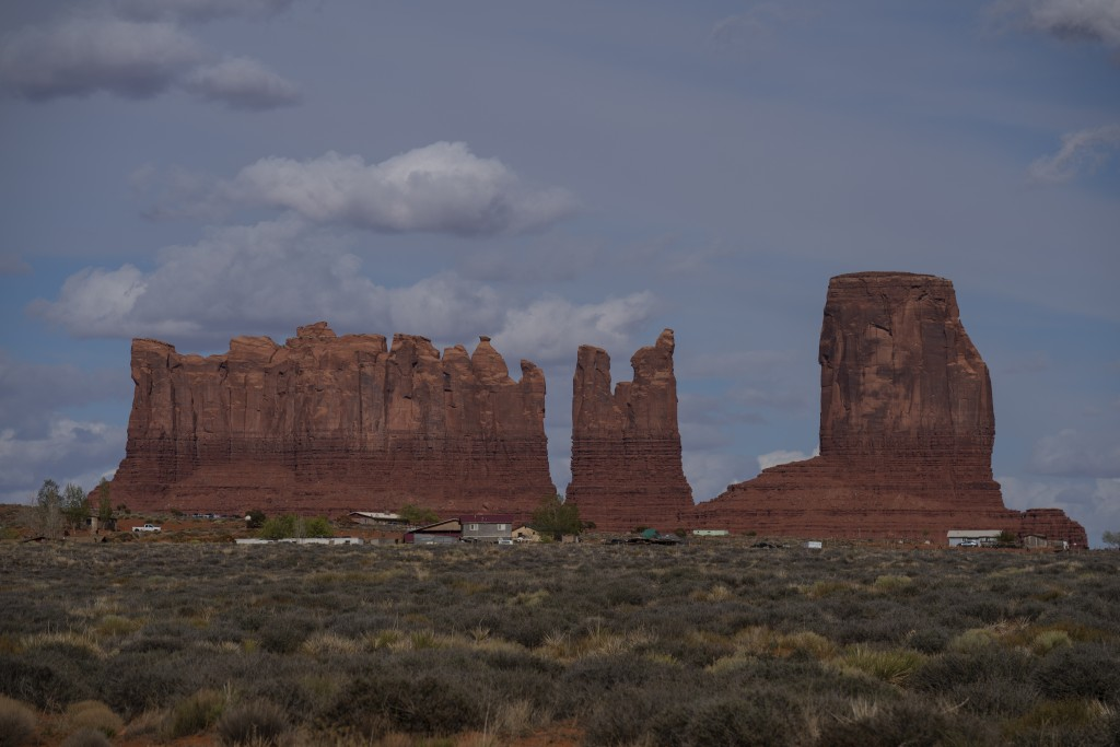 In this April 19, 2020, photo, homes and other structures are seen in Monument Valley, Ariz., on the Navajo reservation. Even before the pandemic, peo...