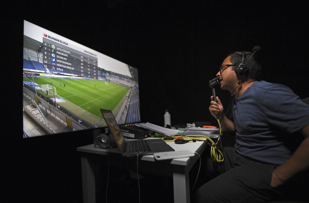 Soccer commentator Mark Scott commentates on the German Bundesliga soccer match between SC Paderborn 07 and TSG 1899 Hoffenheim remotely from a studio...