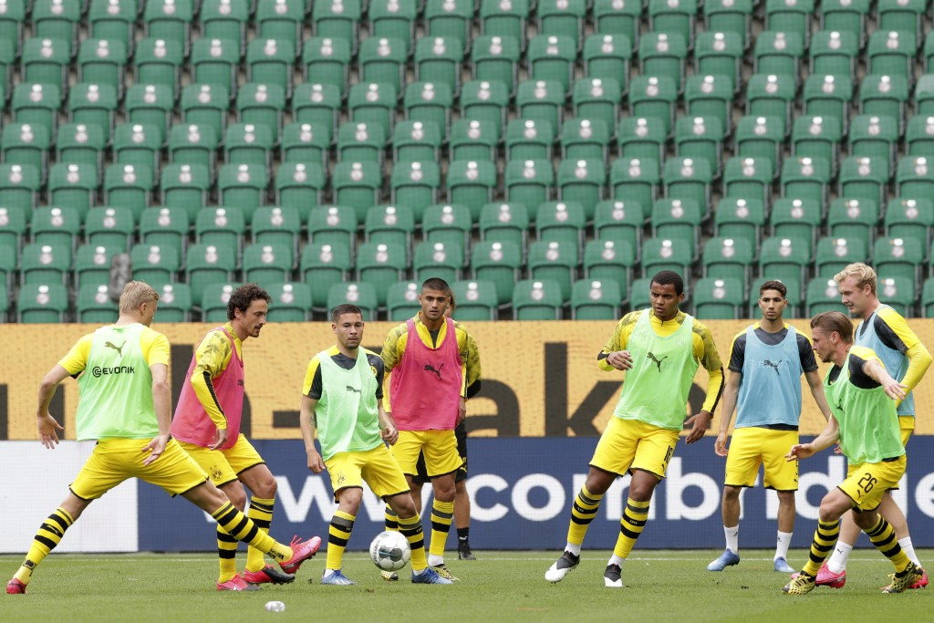 Dortmund players kick a ball during warmup before the German Bundesliga soccer match between VfL Wolfsburg and Borussia Dortmund in Wolfsburg, Germany...