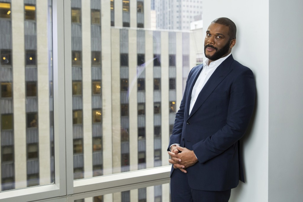 FILE - In this Nov. 16, 2017, file photo, actor-filmmaker and author Tyler Perry poses for a portrait in New York. Perry is looking to reopen his 330-...