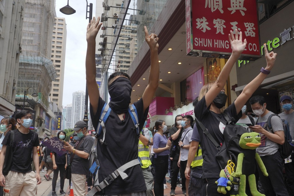Protesters march against Beijing's national security legislation in Hong Kong.
