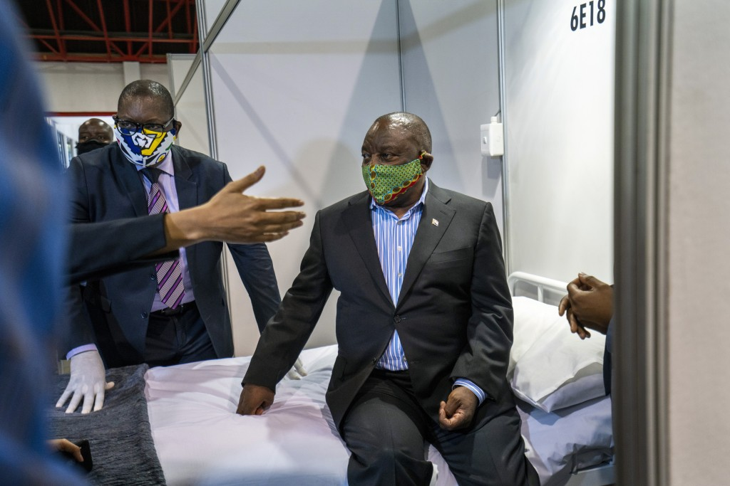 FILE- In this file photo taken Friday, April 24, 2020, South African President Cyril Ramaphosa visits the COVID-19 treatment facilities at the NASREC ...