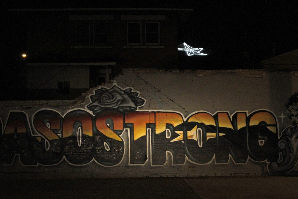 "In this May 7, 2020, photo, an ""El Paso Strong"" mural is seen at night in El Paso, Texas. Gabe Vasquez and Justin Martinez painted the mural in August..."