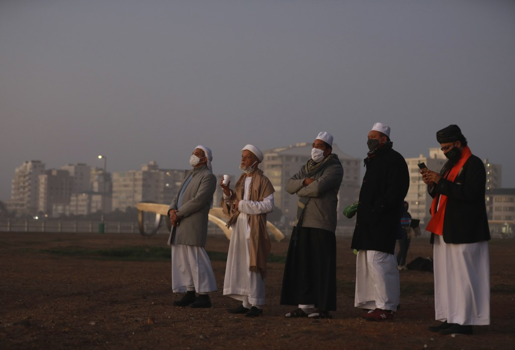 Senior Muslim clerics observes the skies over Cape Town, South Africa Saturday May 23 2020 in the hope of spotting the new moon to mark the end of Ram...