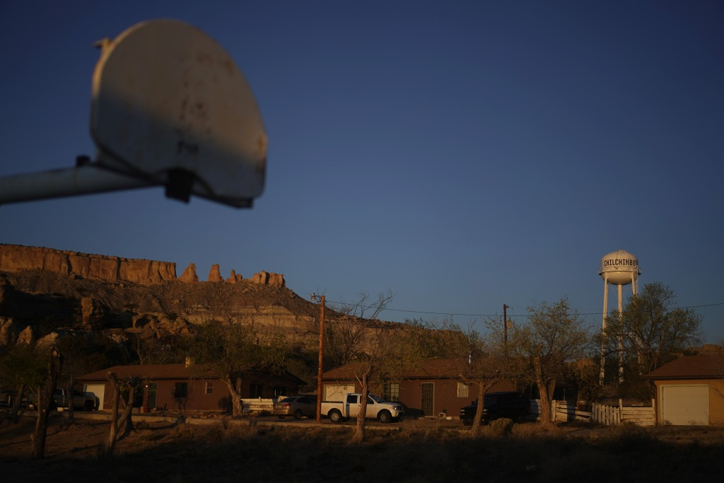 FILE - In this Sunday, April 19, 2020, file photo, the water tower and a basketball backboard at the school in Chilchinbeto, Ariz., on the Navajo rese...