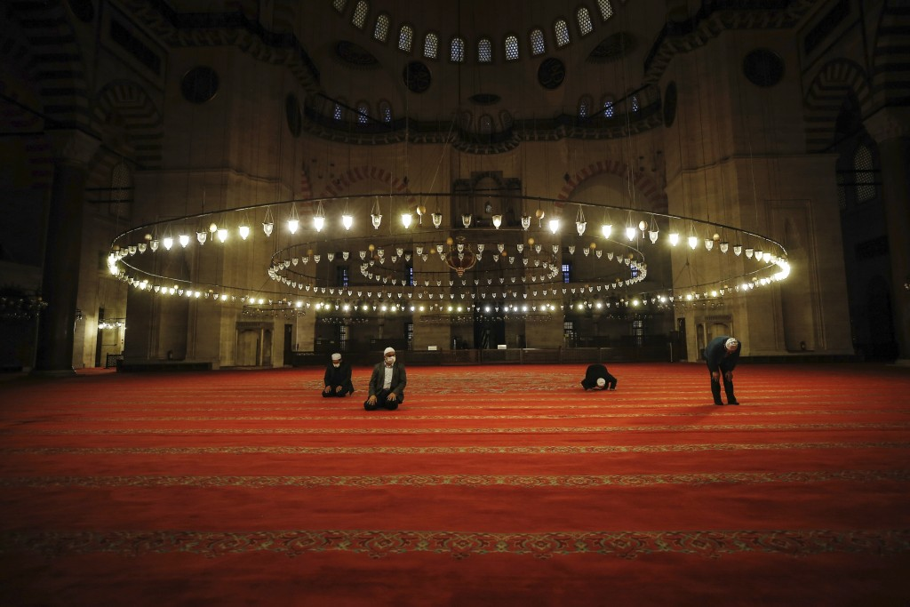 Few face masked people allowed to offer the Eid al-Fitr prayer amid concerns of the coronavirus outbreak at historical Suleymaniye Mosque, in Istanbul...