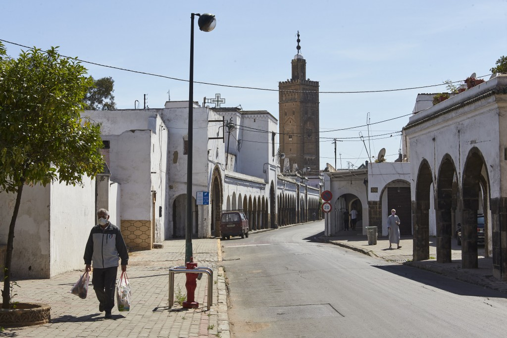 A man leaves one of the markets in the old Habous district of Casablanca where many shops specializing in clothing and party items are closed due to t...