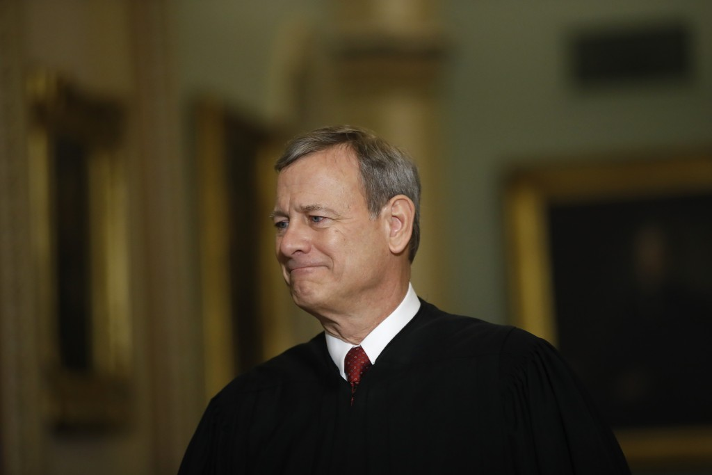 FILE - In this Jan. 16, 2020, file photo Chief Justice of the United States, John Roberts walks to the Senate chamber at the Capitol in Washington. Ro...