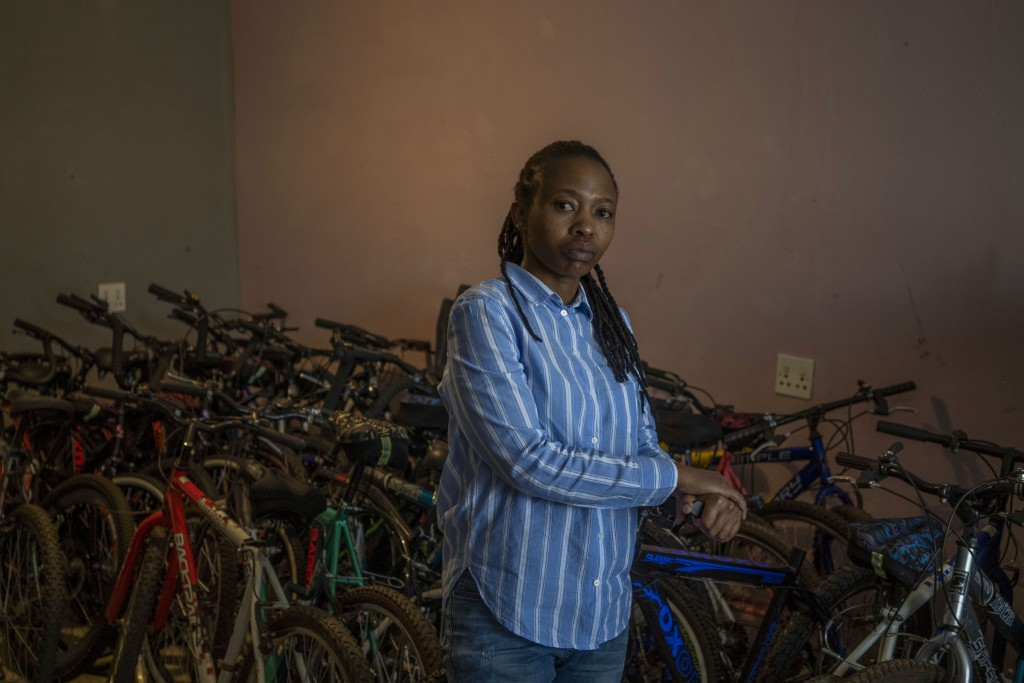In this Friday May 1, 2020 photo, 34-year-old entrepreneur Fino Dlamini poses for a photograph inside her office in the Soweto township outside Johann...