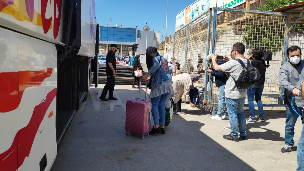 In this Friday, May 22, 2020, photo, Moroccan citizens wait for repatriation after being stranded in Spain due to the coronavirus pandemic in the Span...