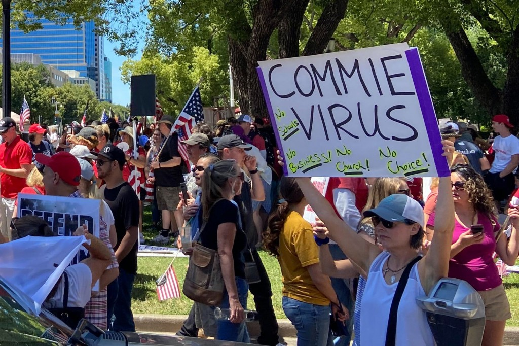 """Protesters gathered outside the """"Liberty Fest"""" rally in front of California State Capitol, Saturday, May 23, 2020, in Sacramento, Calif., to protest G..."""