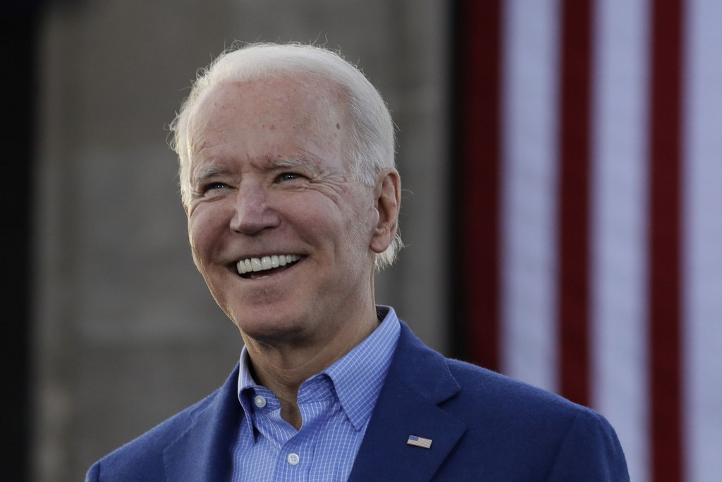 FILE - In this March 7, 2020, file photo, Democratic presidential candidate former Vice President Joe Biden acknowledges the crowd during a campaign r...