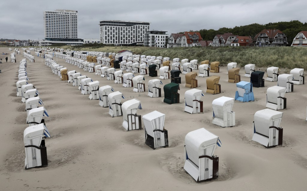 Beach chairs placed in lines at the Baltic Sea beach in Warnemuende, Germany, May 25, 2020. Germany's northern states are starting to reopen the touri...