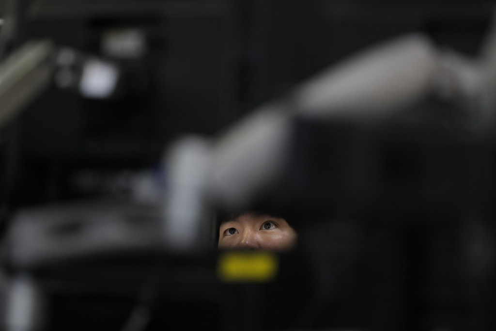 A currency trader watches computer monitors at the foreign exchange dealing room in Seoul, South Korea, Monday, May 25, 2020. Asian shares are mostly ...
