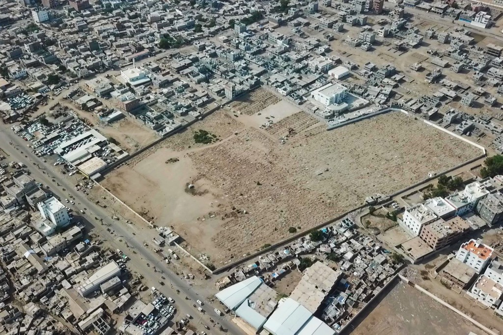 This May 21, 2020, photo, shows a general view of Radwan Cemetery in Aden, Yemen. At the cemetery in Yemen's largest southern city, dozens of fresh gr...