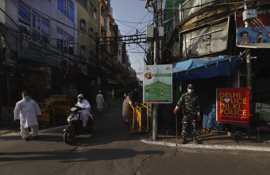 A para-military force soldier stands guard on Eid al-Fitr at the old quarters of New Delhi, India, Monday, May 25, 2020. The holiday of Eid al-Fitr, t...