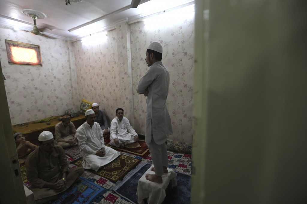 Indian Muslims gather for Eid al-Fitr prayers inside their house in New Delhi, India, Monday, May 25, 2020. The holiday of Eid al-Fitr, the end of the...