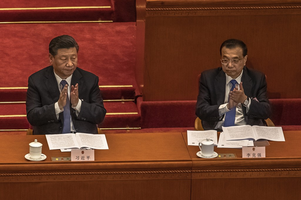 CCP General Secretary Xi Jinping (left) and Premier Li Keqiang.