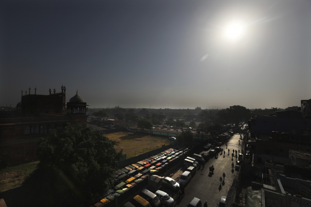The Jama Mosque is silhouetted against the morning sun during Eid al-Fitr at the old quarters of New Delhi, India, Monday, May 25, 2020. The holiday o...