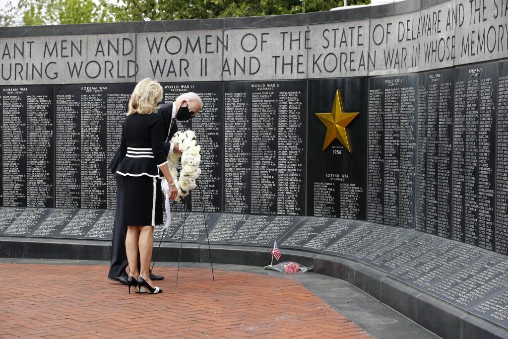 Vice President Joe Biden and Jill Biden place a wreath at the Delaware Memorial Bridge Veterans Memorial Park, Monday, May 25, 2020, in New Castle, De...