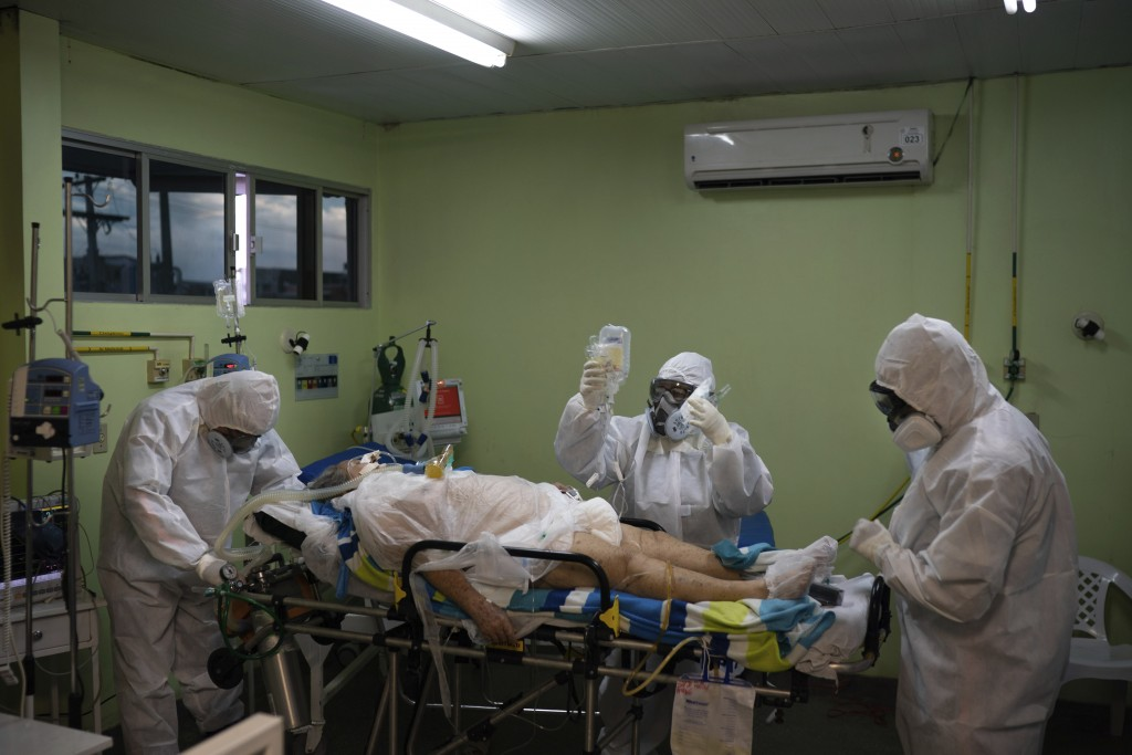 Emergency workers transfer a COVID-19 patient to a hospital in Manaus, Brazil, Friday, May 15, 2020. Per capita, Manaus is Brazil's major city hardest...