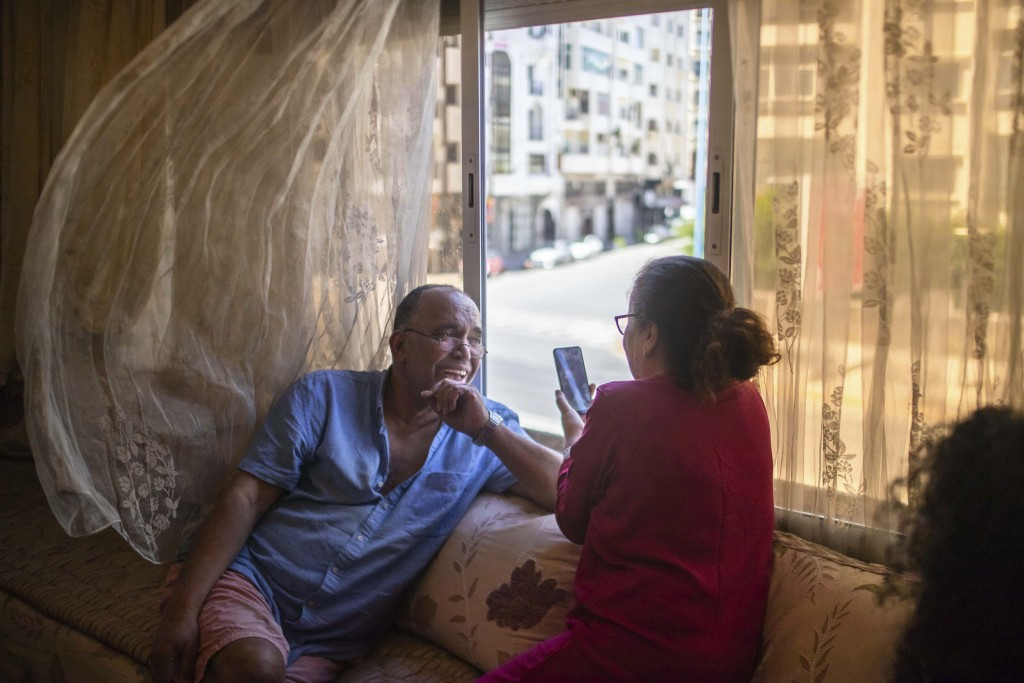 Afifa, right, and her husband, Moustafa, video call with their relatives on the first day of Eid in lockdown due to the Coronavirus pandemic, in Casab...
