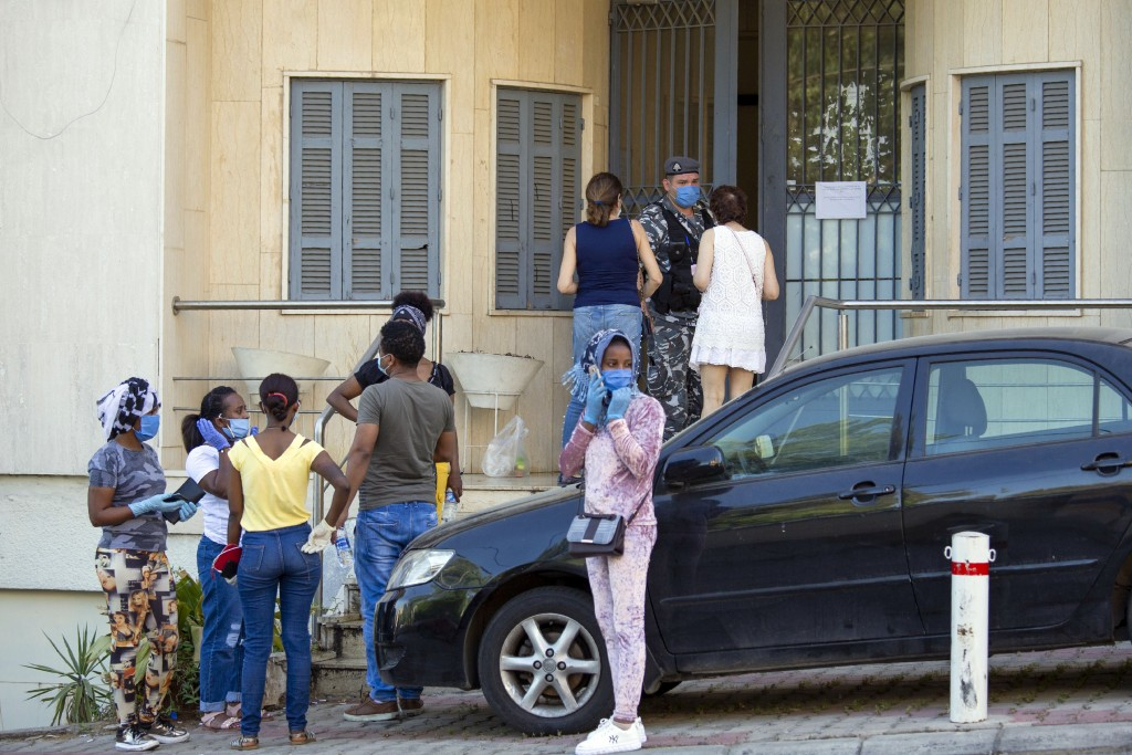 In this Thursday, May 21, 2020 photo, Ethiopian workers wait outside the Ethiopian Consulate in Hazmieh, east of Beirut, Lebanon. Some 250,000 registe...