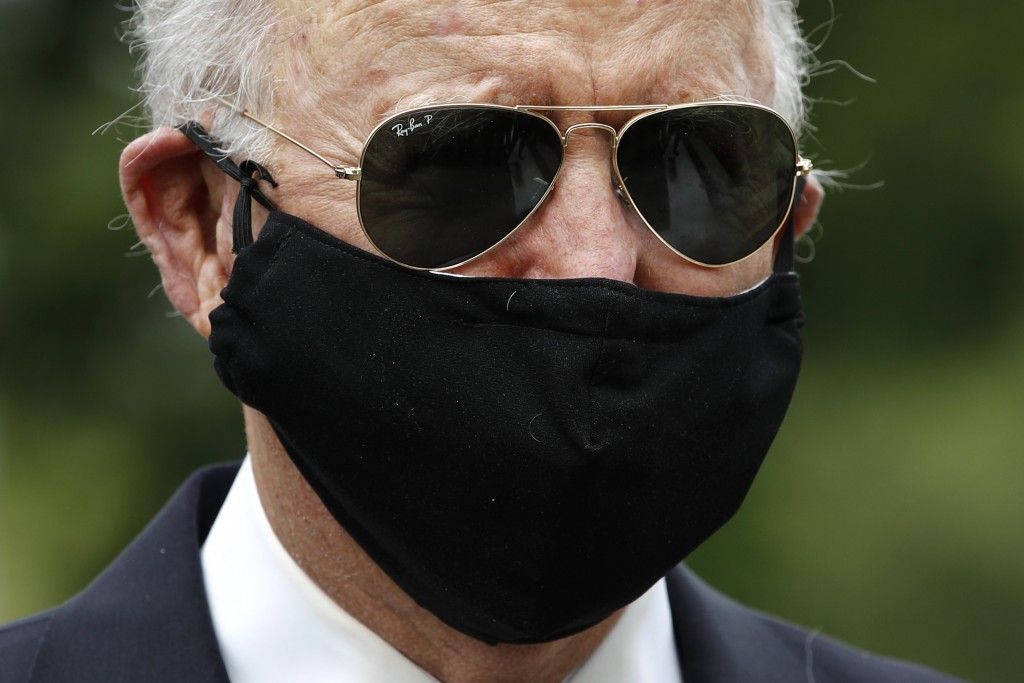Democratic presidential candidate, former Vice President Joe Biden wears a face mask to protect against the spread of the new coronavirus as he and Ji...