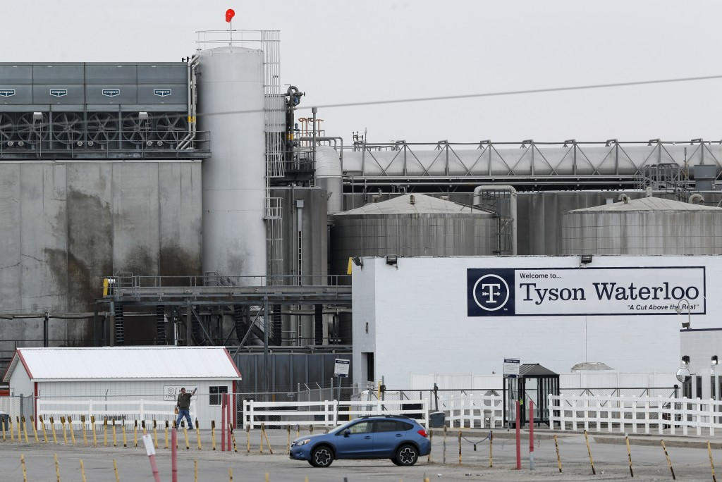 FILE - In this May 1, 2020, file photo, a worker leaves the Tyson Foods plant in Waterloo, Iowa. An employee at the Waterloo plant died Monday, May 25...