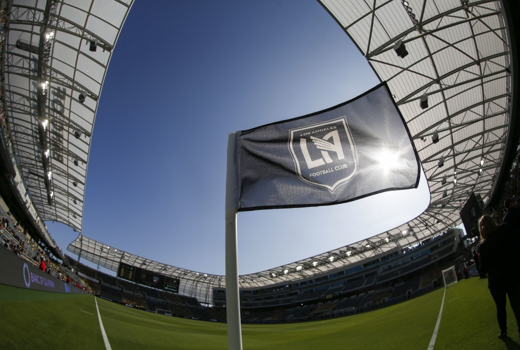 FILE - In this April 29, 2018 file photo taken with a fisheye lens, a flag flies at the Banc of California Stadium prior to an MLS soccer game between...