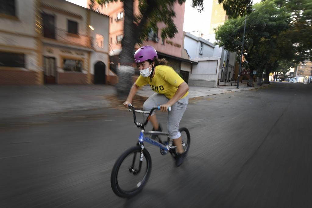 Venezuelan Olympic medalist Stefany Hernandez, a BMX racing cyclist, wears a face mask while training in Caracas, Venezuela, Saturday, April 25, 2020....